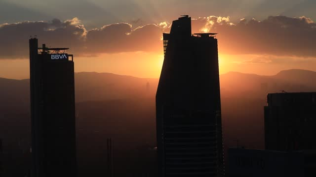 """rays of sun escape behind downtown skyscrapers in """"reforma"""" business district on december 14, 2020 in mexico city, mexico. mexico city authorities... - bank stock videos & royalty-free footage"""