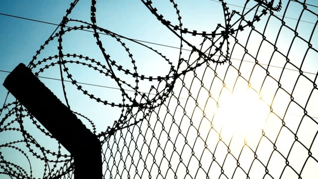 razor wire, sky and sun - fence stock videos & royalty-free footage
