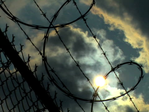 razorwire clouds - barbed wire stock videos & royalty-free footage