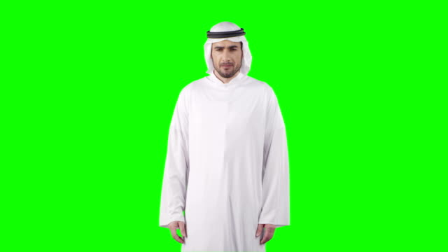 reaching invisible object on a virtual touch screen. green screen with alpha - middle eastern culture stock videos & royalty-free footage