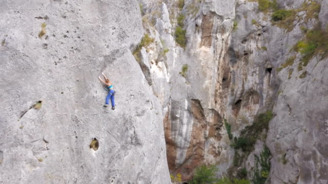 reaching new heights - rock face stock videos & royalty-free footage