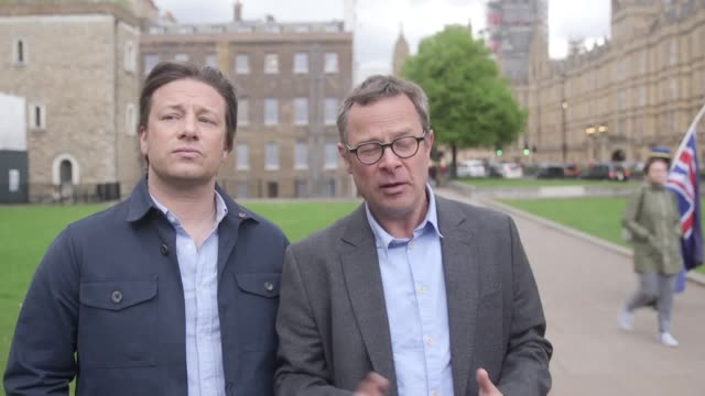reaction from jamie oliver and fellow celebrity chef hugh fearnley-whittingstall after giving evidence on childhood obesity at a health and social... - jamie oliver stock videos & royalty-free footage