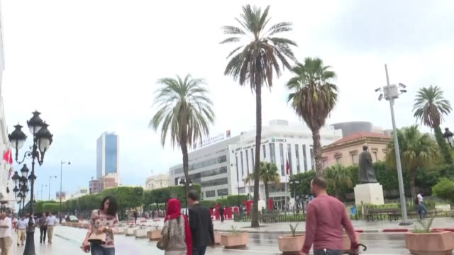 reaction is mixed on the streets of tunis as exit polls show an established islamist-inspired party leading that of a jailed business tycoon in... - tunis stock videos & royalty-free footage