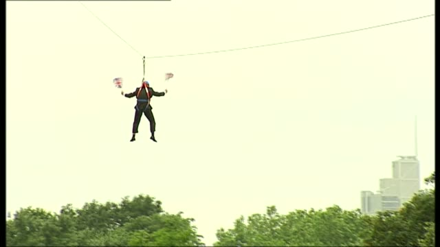 reaction to boris johnson appointment as foreign secretary t01081253 / tx ext boris johnson stuck on zip wire zipwire holding union flags - raw footage stock videos & royalty-free footage