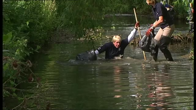 reaction to boris johnson appointment as foreign secretary t04060920 / tx ext johnson falling into river - falling stock videos & royalty-free footage