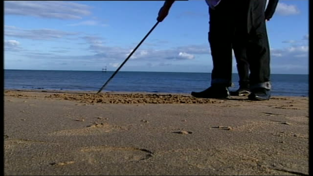 reaction to david cameron's plans for immigration and the eu kent south thanet ramsgate ext low angle view stick being used to draw on sand - ramsgate stock videos & royalty-free footage