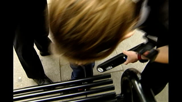 Reaction to escalation of Stop and Search measures in London DATE Anonymous youth being searched by police officers with metal detector being used to...