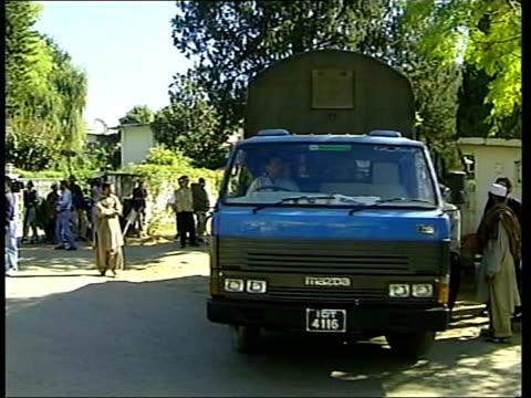 reaction to fall of kabul; itn pakistan: islamabad: ext taliban diplomats taliban diplomats along partly covering faces taliban diplomats along in... - no parking sign stock videos & royalty-free footage