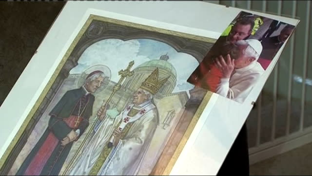 reaction to pope resignation int adam iche and amy iche playing with daughter photograph of pope benedict blessing daughter adam iche watching... - 法王ベネディクト16世点の映像素材/bロール