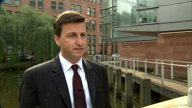 reaction to possible uk military action against islamic state; england: manchester: ext douglas alexander mp interview sot - support action taken by... - douglas alexander stock videos & royalty-free footage