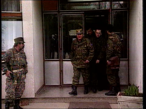 reaction to video of srebrenica massacre of muslims date general ratko mladic out of building with other military officers - srebrenica stock videos and b-roll footage