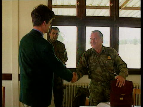 reaction to video of srebrenica massacre of muslims september 1995 channel four journalist shakes hands with mladic cs badge on mladic's uniform... - ratko mladic stock videos & royalty-free footage