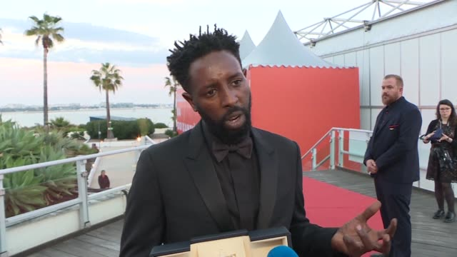 reaction with french director ladj ly director of les miserables whose debut film is joint winner of the jury prize at this year's cannes film... - 72nd international cannes film festival stock videos and b-roll footage