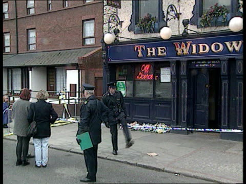 reactions to loughinsland murders itn lib eire dublin seq police outside 'the widow scallans' pub folowing loyalist attack - murder stock videos & royalty-free footage