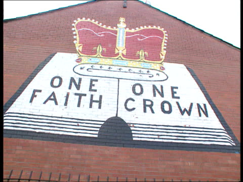 reactions to loughinsland murders itn lib northern ireland west belfast ms uvf mural on wall this is loyalist west belfastshankillno surrender la ms... - killing stock videos & royalty-free footage
