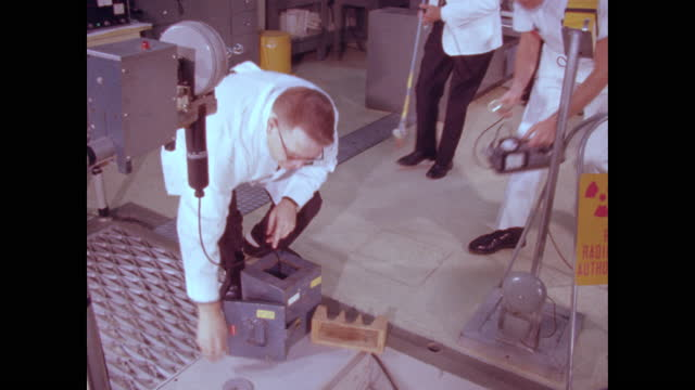 cu reactor core pan away to three workers testing core sample with radiation gague and no ppe - indoors stock videos & royalty-free footage