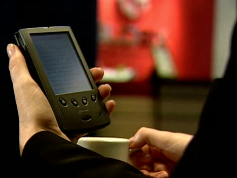 a reader uses a handheld electronic book 2000 - kindle stock videos & royalty-free footage