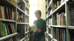 Reading a book in library
