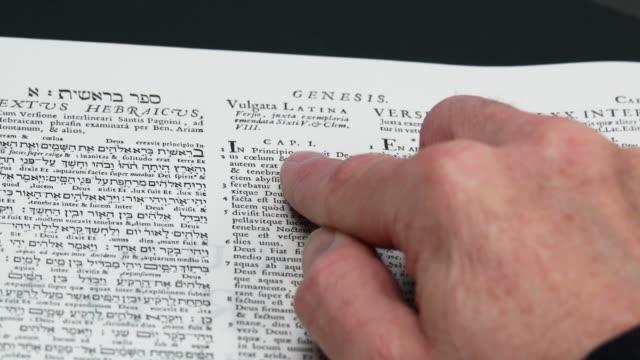 HD Reading Genesis 1:26-27 (Rack Focus) (4:2:2)