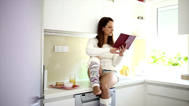 Reading in the kitchen