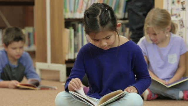 reading in the public library - elementary school stock videos & royalty-free footage