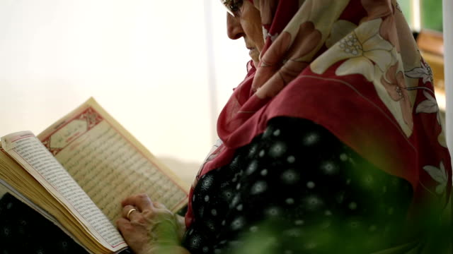 reading koran - senior women stock videos & royalty-free footage