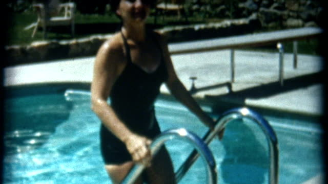 reading magazine poolside 1950's - swimming stock videos & royalty-free footage