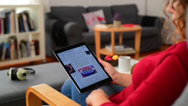 reading news on tablet pc - newspaper stock videos & royalty-free footage