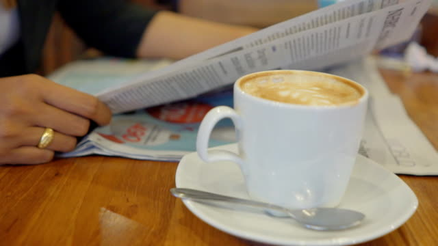 reading newspaper and drink coffee - patio stock videos & royalty-free footage