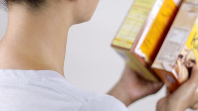 reading nutritional label and comparing products - label stock videos & royalty-free footage
