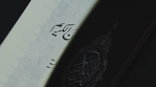 reading quran, close up of noble quran. - koran stock videos & royalty-free footage