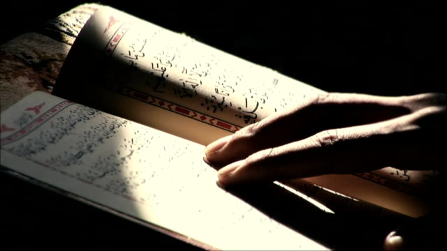 reading quran in the mosque - islam stock videos & royalty-free footage