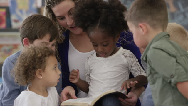reading the bible - nursery school child stock videos & royalty-free footage