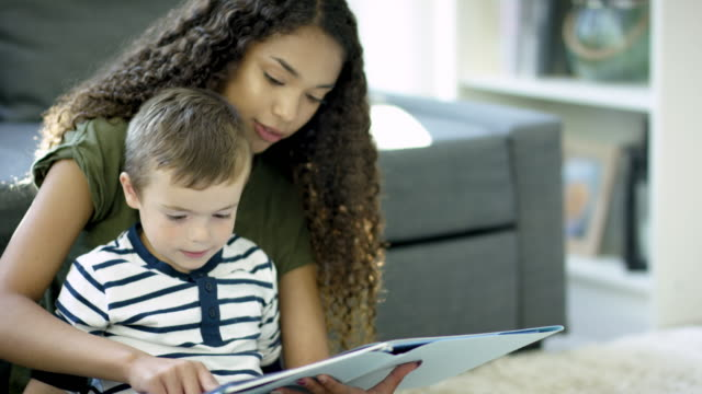 reading to young boy - showing stock videos & royalty-free footage