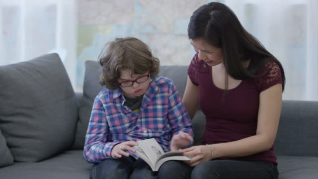 reading with an education assistant - deafness stock videos and b-roll footage