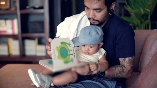 reading with dad - picture book stock videos and b-roll footage