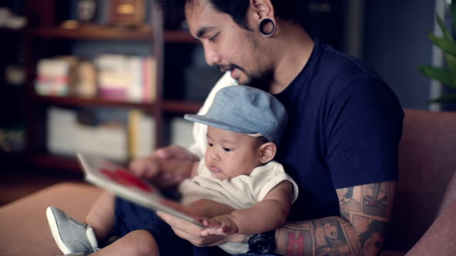 reading with father - life events stock videos & royalty-free footage
