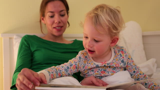reading with mummy - bedtime stock videos & royalty-free footage