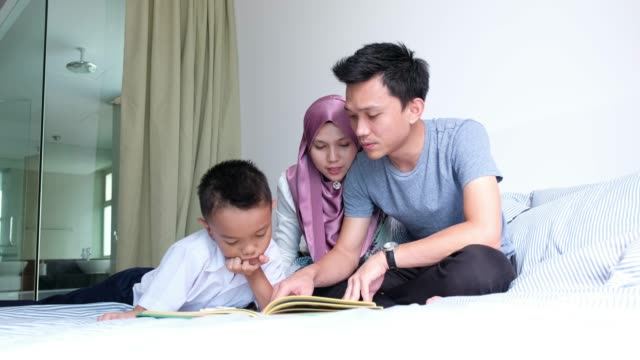 reading with my parents - malay family stock videos and b-roll footage