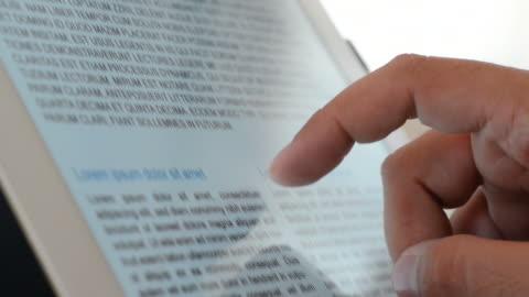 stockvideo's en b-roll-footage met reading with tablet pc - krant