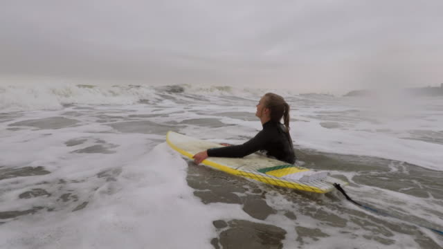 ready to hit the wave - wetsuit stock videos & royalty-free footage