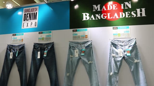 readymade garments product buyers and sellers visit bangladesh denim expo at bashundhara international convention city in dhaka. 10 may 2018.... - garment stock videos & royalty-free footage