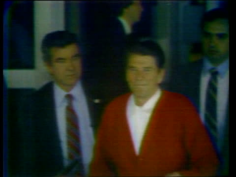 reagan leaves hospital after assassination attempt usa washington ls ronald reagan out of hospital with wife nancy and daughter maureen to car sof... - assassination stock videos & royalty-free footage