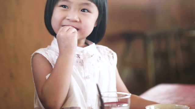 real asian daughter eatting - cereal plant stock videos & royalty-free footage