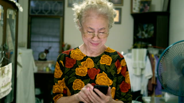 real asian elderly women using phone - silver surfer stock videos & royalty-free footage