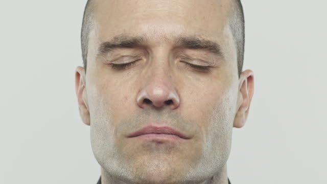 real caucasian adult man closing eyes - serene people stock videos & royalty-free footage