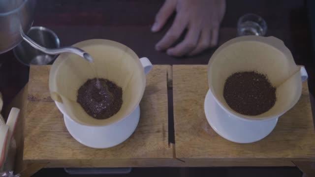 dippen bohnenkaffee - teekessel stock-videos und b-roll-filmmaterial