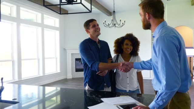 real estate agent closes deal on new home - house stock videos & royalty-free footage