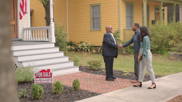 a real estate agent meets two clients in front of a new listing - wilmington north carolina stock videos & royalty-free footage