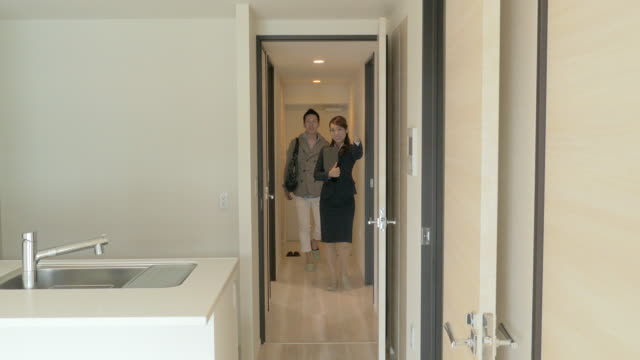 Real Estate Agent Showing Rooms to Buyers